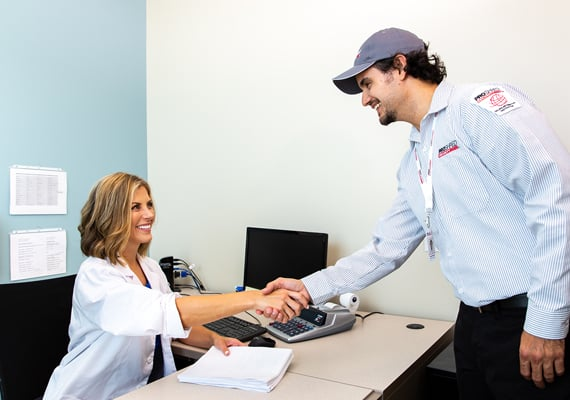 Document Shredding Professional Shaking Hands with Medical Professional