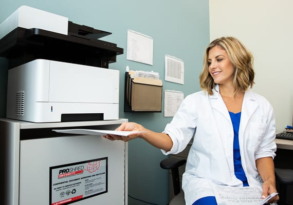 Medical professional shredding documents