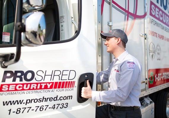 employee entering a mobile shredding truck