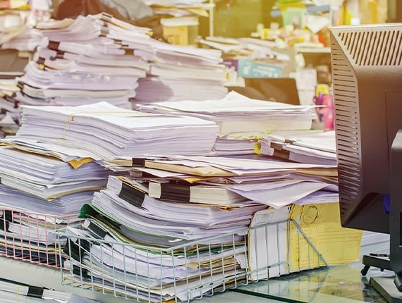 Messy pile of paper documents.